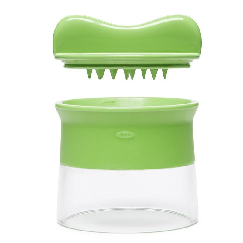 a plastic container, whose body is half transparent and half in green and whose cap is in green with thorns in the inner side